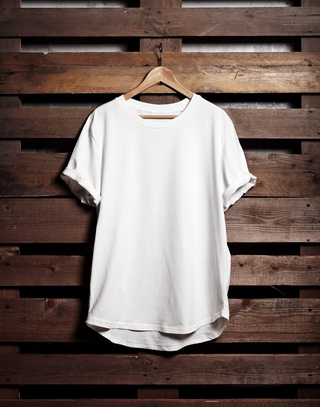 Blanc white tshirt hanging on wood background