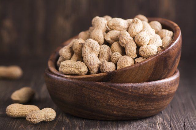 Peanuts in wooden bowls