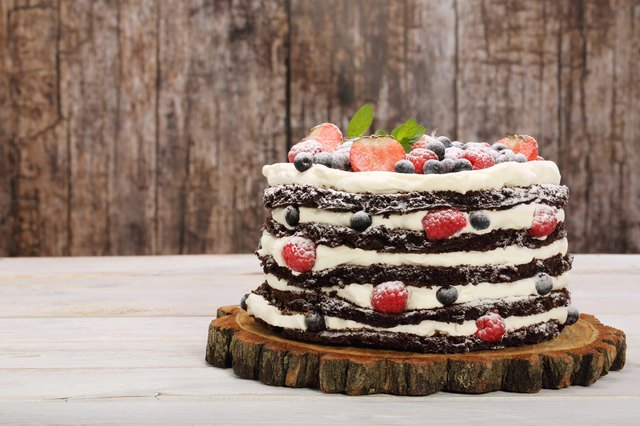 Chocolate cake with white cream and fresh fruits