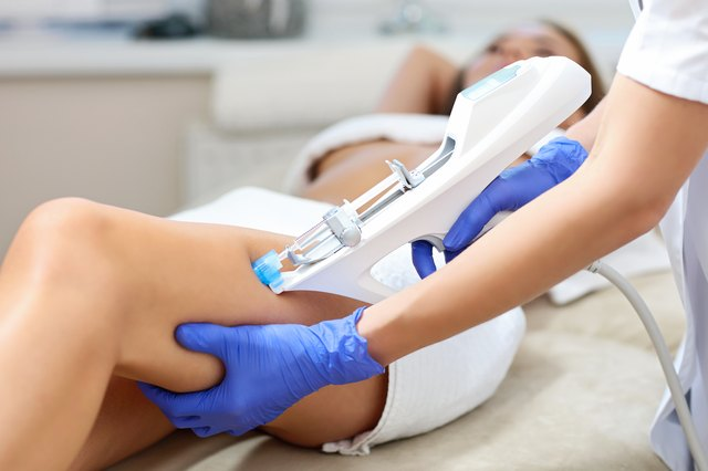 Woman having leg mesotherapy in beauty salon