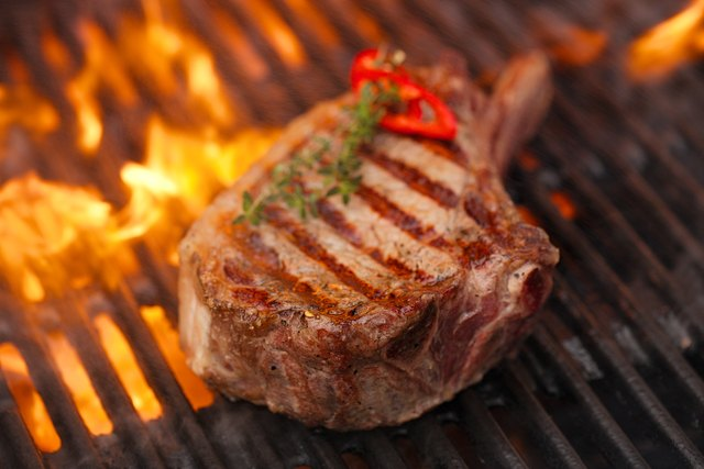 food meat - beef steak on bbq barbecue grill with
