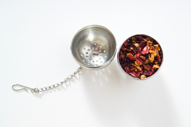 Tea strainer, fruit tea, white background