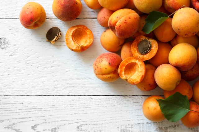 Whole orange apricots with red blush.