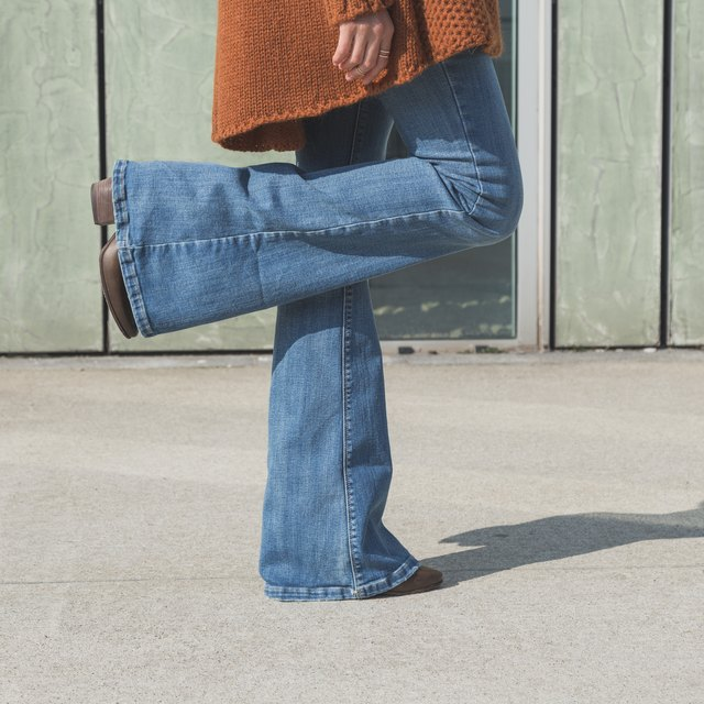 Woman in blue bellbottom jeans