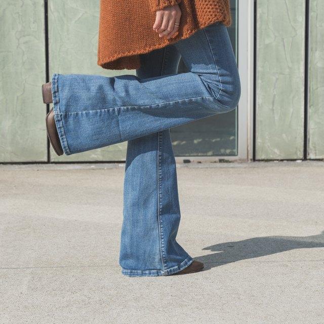 Woman in blue bellbottom jeans