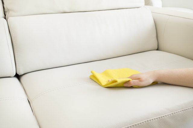 Polishing a pleather couch with soft cloth