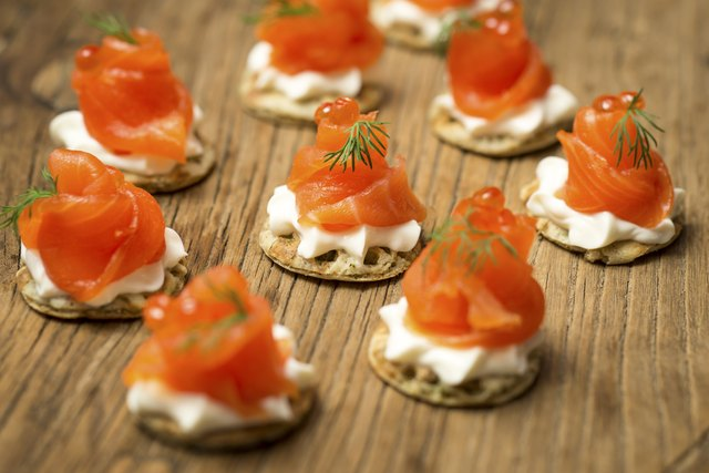 Smoked Trout Blinis on a wooden board