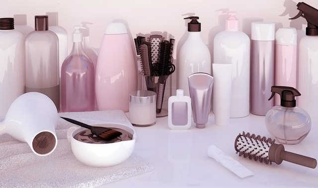Hairdresser Accessories for coloring hair on a white table.