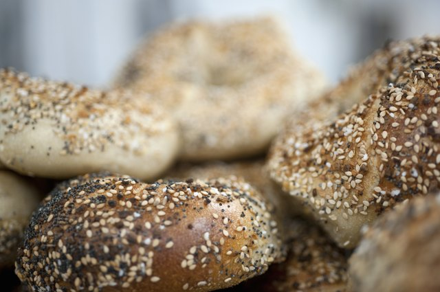 A pile of fresh 'everything' seeded bagels