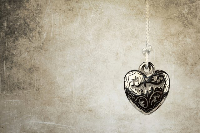 Heart pendant on grunge background