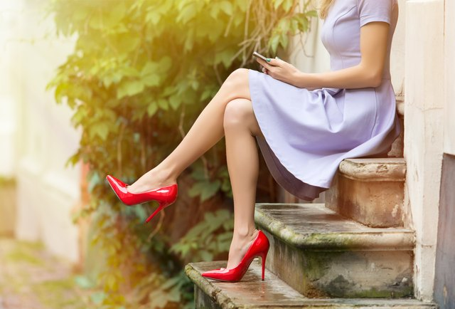 Fashionable woman sitting on stairs