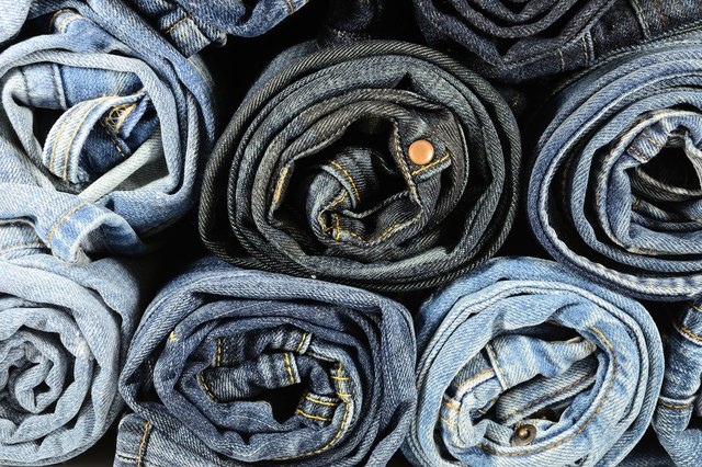 A stack of rolled up blue jeans