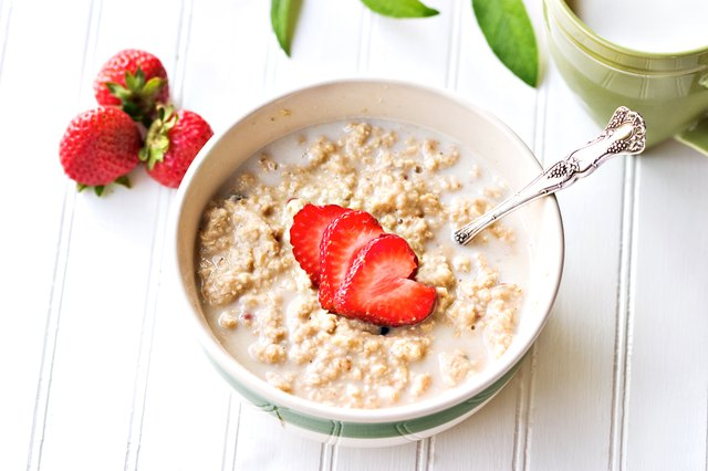 A bowl of oatmeal with strawberries