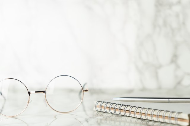 Glasses and notebook on luxury marble surface