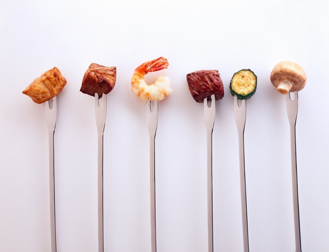 Set of fondue forks with various foods