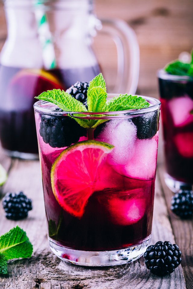 Blackberry mojito  cocktail  with lime, and mint