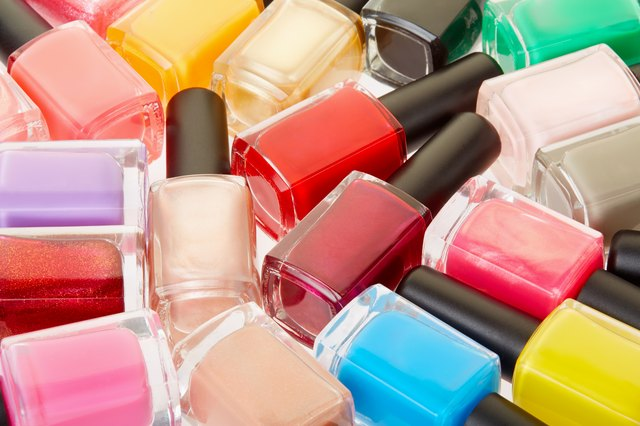 Nail polish colorful bottles background