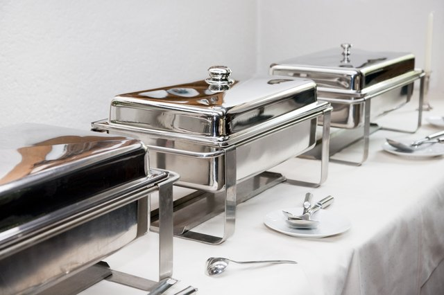chafing dishes on a buffet table