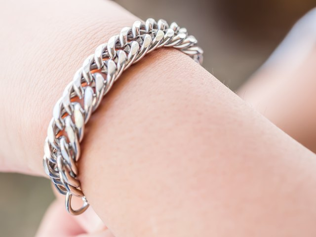Closeup of silvertone metal bracelet