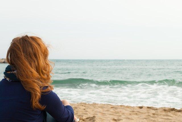 Redhead girl on a Barcelona sand beach
