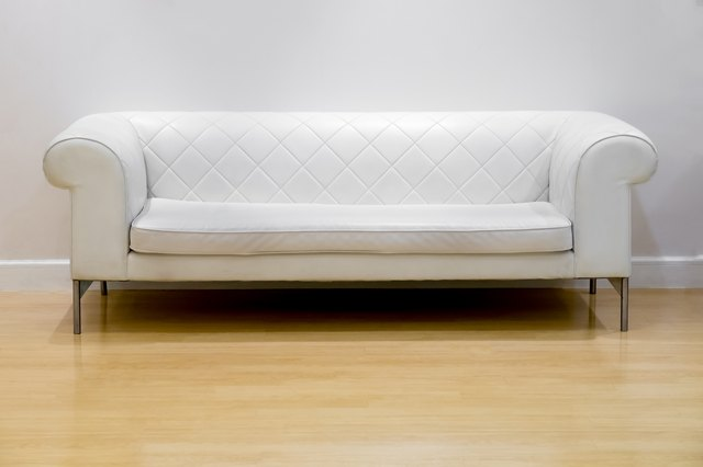 White leather sofa and wood floor
