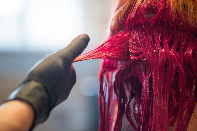 Woman Getting Hair Dyed Red