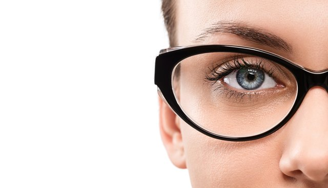 Woman with blue eyes wearing eye glasses