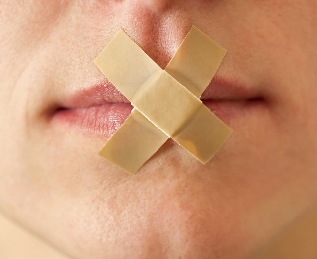 Woman with bandages across her lips