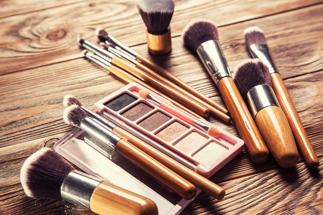 Brushes with cosmetics scattered chaotically