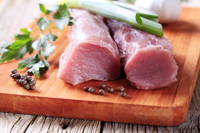 Close-up of raw pork tenderloin with spices