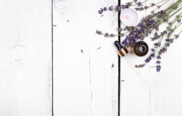 Dry lavender and oil  on a white wooden table
