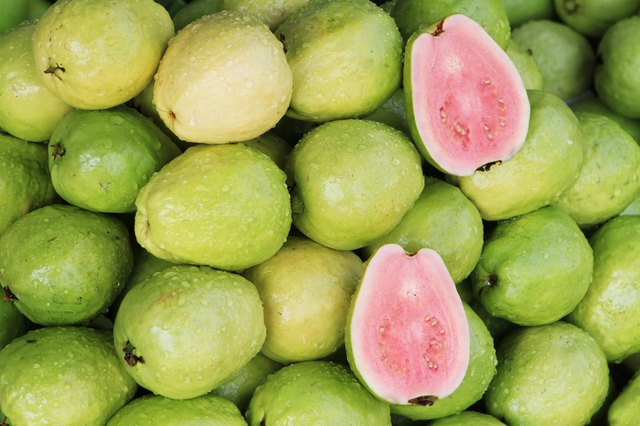A photo of fresh red guavas, a typical tropical fruit