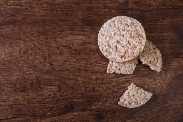 Rice biscuits on grunge rustic wood background.