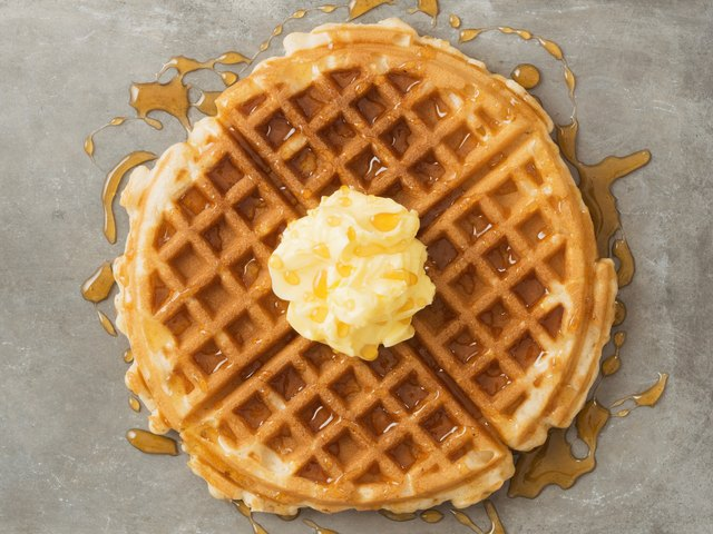 rustic traditional waffle with butter and maple syrup
