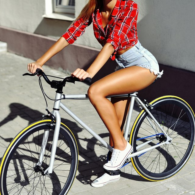 Sexy fit woman on a bicycle - close up