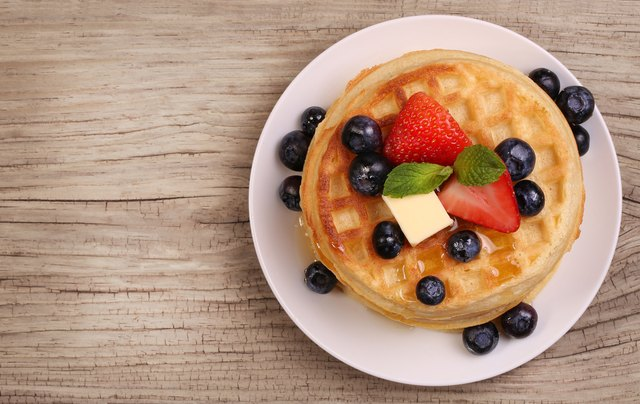 Waffles with Strawberry and Blueberry over wooden background