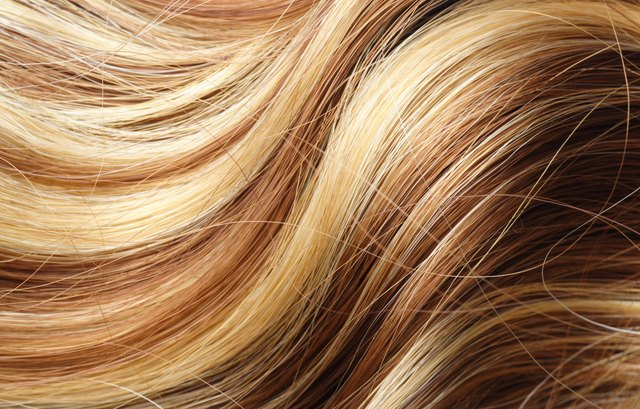 A woman's long blonde highlighted hair