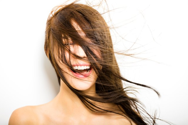young Woman  with hair motion on white background