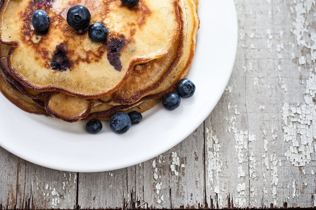 White plate with blueberry pancakes