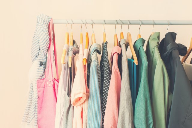 Pastel Color Female Clothes in a Row on Open Hanger
