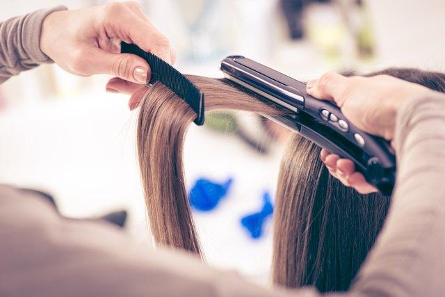 Hair dresser using an electric flat iron