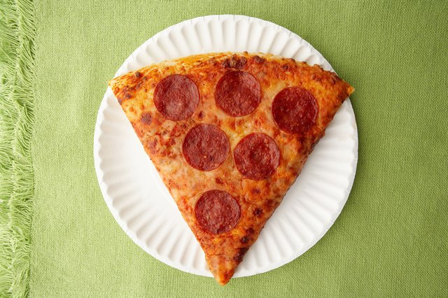 Pepperoni pizza on paper plate