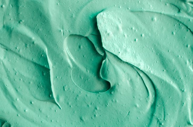 Green cosmetic clay texture close up. Abstract background.