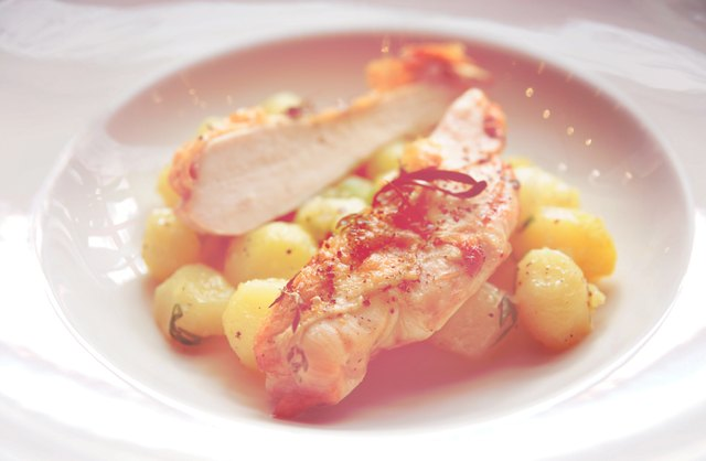 Chicken breast with potatoes on plate, toned
