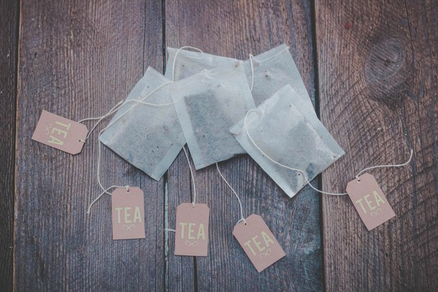 Tea bags on wooden background