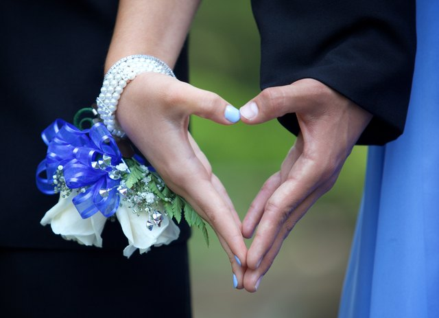 Prom Couple Forming a Heart with their Hands  Close Up