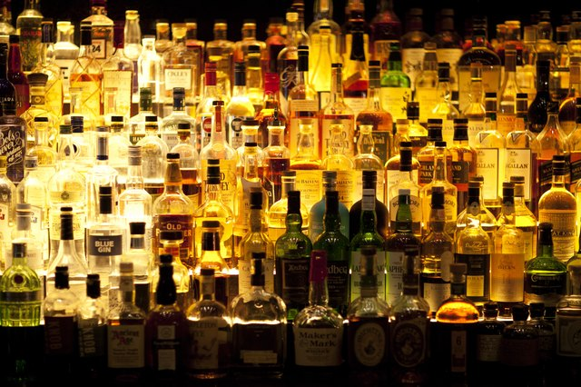 Various Liquor bottles backlit.