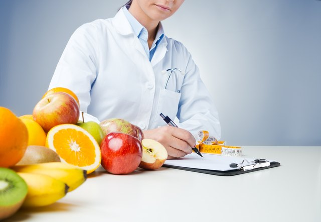 Professional nutritionist writing medical records