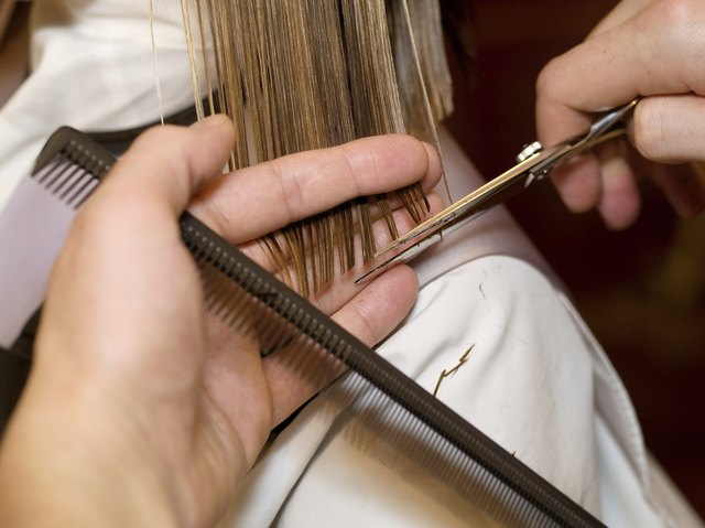 Close-up of a hairdresser cutting a clients hair