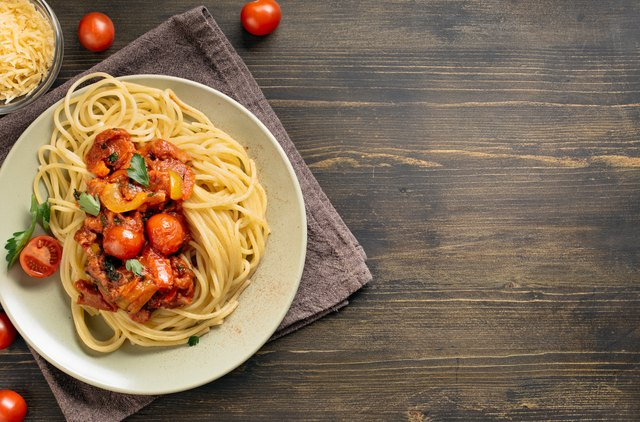 Spaghetti pasta on table with copy space